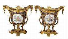 A pair of gilt-bronze mounted Sevres-style porcelain twin handled...