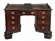 An Edwardian mahogany serpentine fronted desk, in George III style , circa 1910