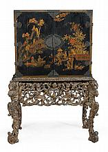 A black lacquer and chinoiserie decorated cabinet