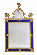 A gilt metal and blue glass mounted wall mirror possibly Dutch or Scandinavian