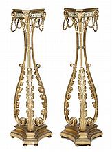 A pair of giltwood, composition and painted torchere stands