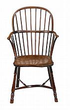 A yew and elm high back Windsor armchair, second quarter 19th century