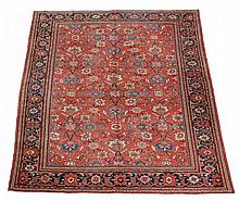 A Mahal carpet , the madder field decorated profusely with navy
