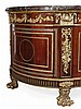 A French mahogany, gilt metal mounted and marble topped commode