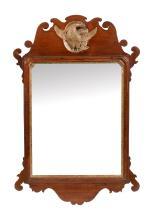 An early George III mahogany and parcel gilt fretwork wall mirror, circa 1760