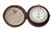 A Victorian gilt brass aneroid pocket barometer