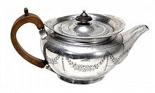 A George III silver compressed spherical tea pot
