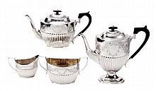 A late Victorian silver oval four piece tea and