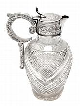 An Edwardian silver mounted cut glass claret jug,