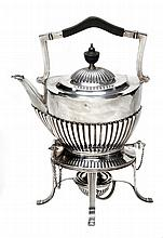 A silver tea kettle on stand by Goldsmiths &