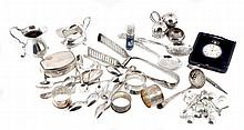 A collection of silver items, to include: a pair of asparagus tongs by...