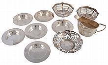 A set of six Edwardian silver circular ash trays by Hukin & Heath