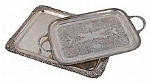 An electro-plated oblong tray, with a chased shell, foliate and floral border