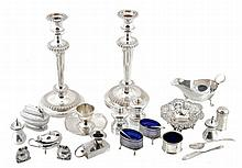 A collection of silver items, to include: a pair of silver frog shaped salt...