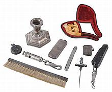 A collection of silver items, to include: a dwarf candlestick by S. M. Levi Ltd