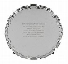 The Rhun Perpetual Challenge Trophy, a silver shaped circular salver by...