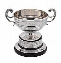 The Armscote Perpetual Challenge Cup, an Edwardian silver twin handled...