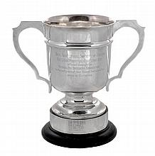 The Laird Perpetual Challenge Cup, a silver twin handled trophy cup