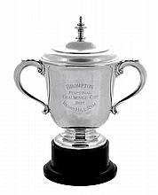 The Brompton Perpetual Challenge Cup, a silver twin handled trophy cup and...