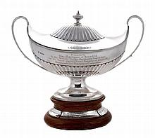The Mallinson Trophy, a silver oval twin handled soup tureen and cover by...