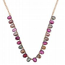 A multi gem set necklace, the necklace suspending