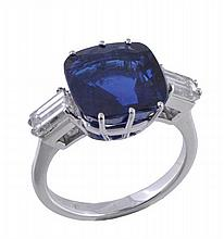A sapphire and diamond ring, the cushion cut