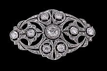 A diamond plaque brooch, circa 1930, the pierced