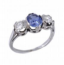 A sapphire and diamond three stone ring, the