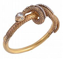 A Victorian diamond set hinged snake bangle, circa