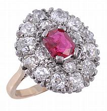 A ruby and diamond cluster ring, the central oval