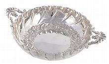 A late Victorian silver shaped circular sweetmeat dish by Charles Edwards