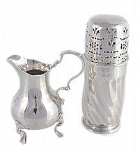 A late Victorian silver baluster cream jug, maker's mark obscured, London 1899