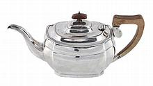 A silver faceted rectangular tea pot by J. W. Benson Ltd
