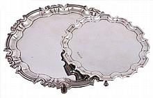 A late Edwardian silver shaped circular salver by William Hutton & Sons Ltd