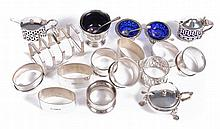 A collection of silver condiment items, including