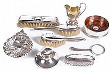 A collection of silver items, to include: a wine coaster by M. C