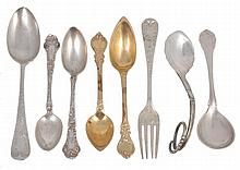A collection of silver small flatware, including