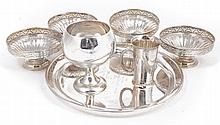 A collection of Indian colonial silver coloured items, comprising