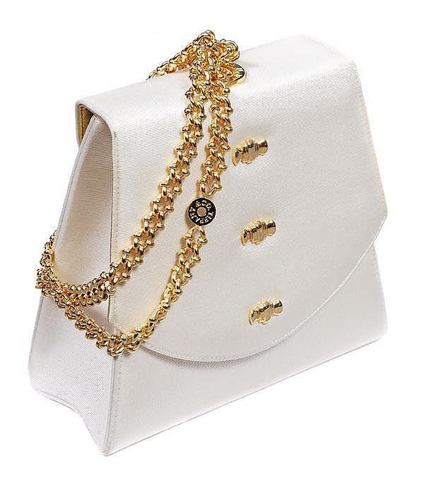 Tiffany & Co, a cream silk grossgrain evening bag,