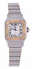 * Cartier, Santos, a lady's two colour wristwatch,