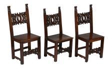 A set of three North Italian walnut side chairs , 17th century