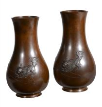 A pair of Japanese bronze vases, of Meiji period, of baluster form