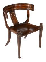 A mahogany and brass inlaid chair, in the manner of Thomas Hope , circa 1810