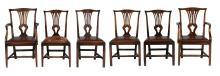 A set of seven mahogany dining chairs including a pair of armchairs