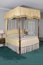 A mahogany four poster bed, 19th century with later adaptations