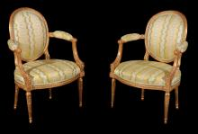 A pair of Louis XVI giltwood open armchairs , circa 1775