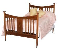 An Edwardian mahogany double bed, circa 1910