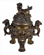 A large bronze tripod censer, the bulbous body