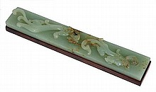 A Chinese jade desk piece carved with relief