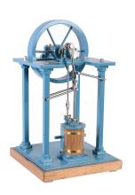 A well engineered model of an over-type vertical live steam mill engine